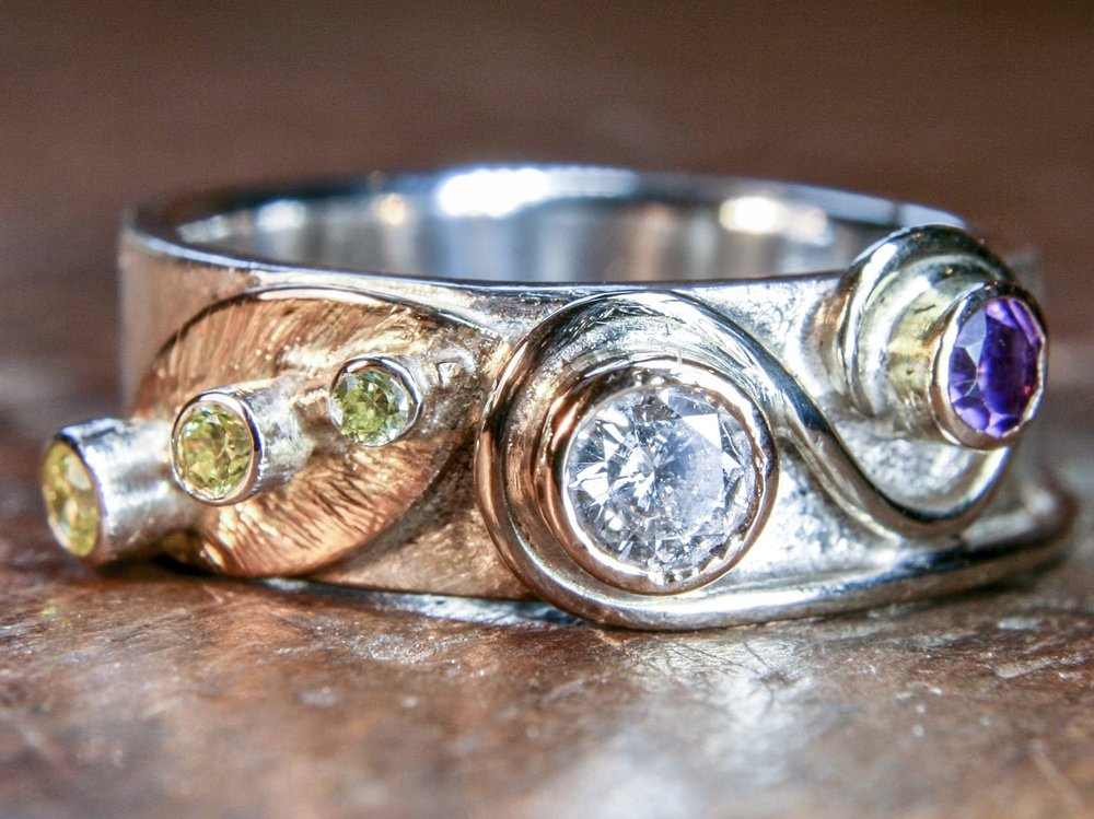 Multi-stone remodelled ring