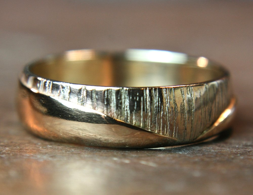 This ring was made by combining the clients parent's wedding rings to make one new ring, inspired by the Malvern Hills.