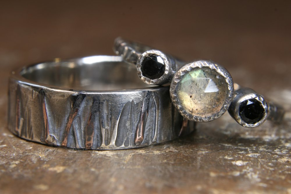 Eco-gothic rings set with black spinel and labradorite