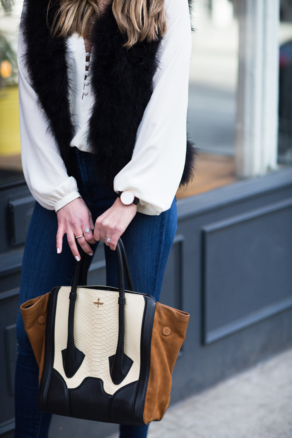 black, brown and cream handbag