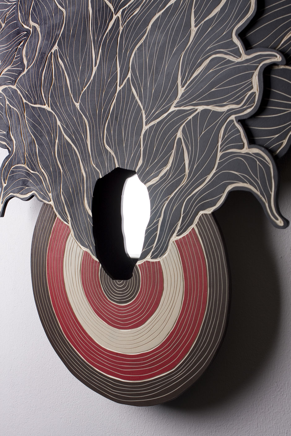 Detail of:   TARGET.PRACTICE #02 by Alex Diamond | woodcut, acrylic paint, mirror;  78 x 62 x 3 cm (2014)