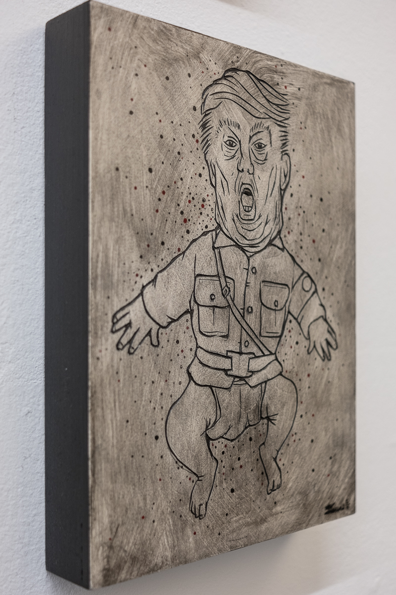 "Side view of: Alex Diamond: RESIST (Trumpomania) Painted woodcut (2017). Wood, acrylic paint, 18 x 24 x 3 cm (7,1"" x 9,5"" x 1,2"")."