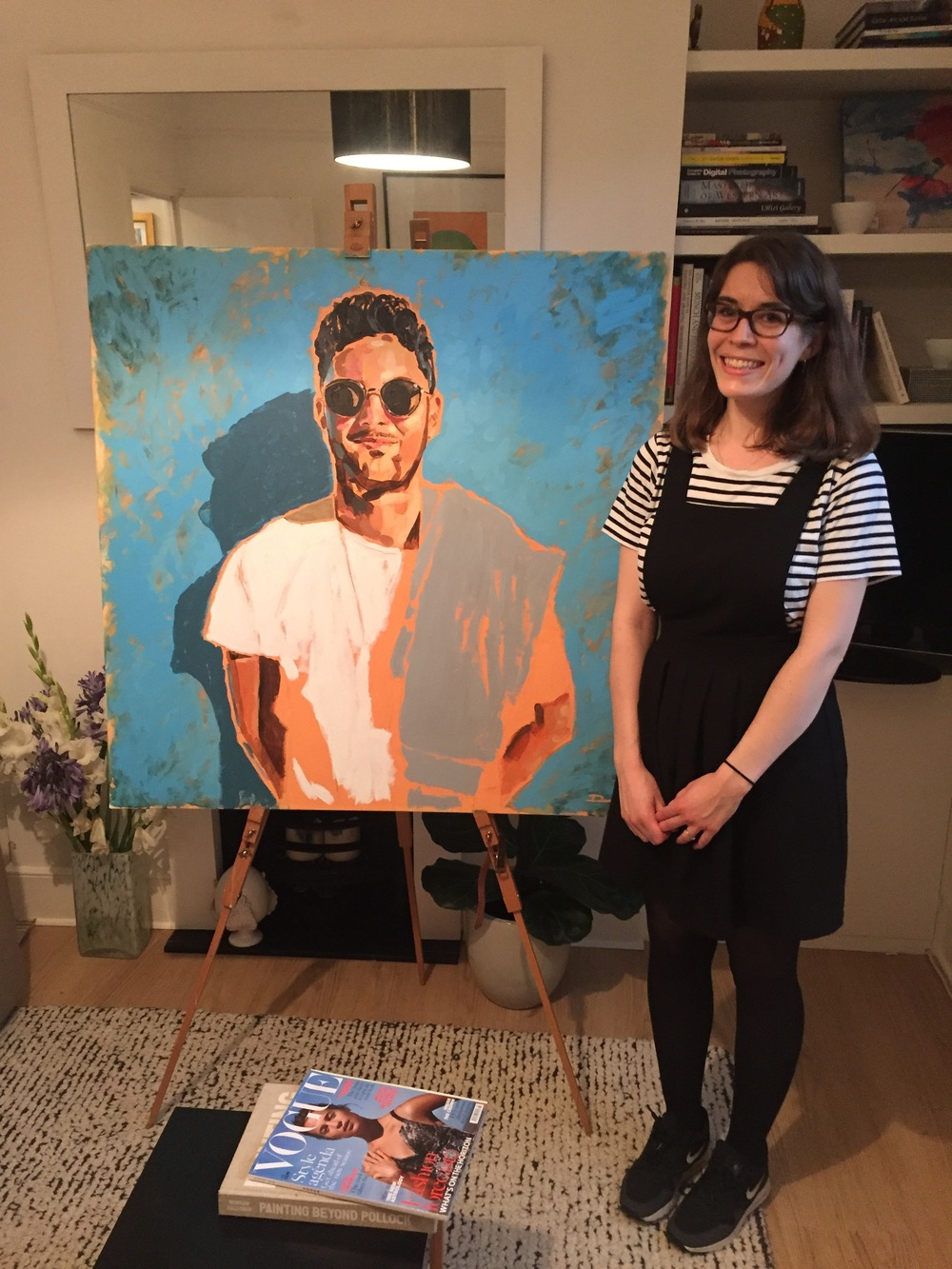 A lovely picture of Nikki in front of her gift painting