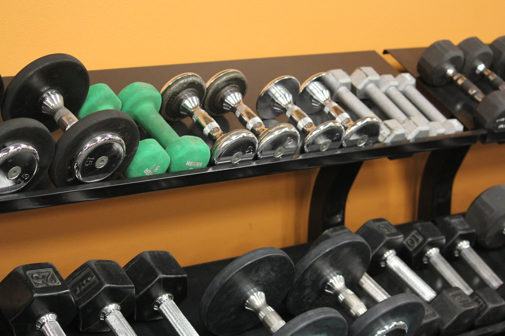 Free Weights - Work your way up to heavier lifting in our free weight section. Alternate between dumbbells, barbells and kettlebells for optimal results. Don't know how to lift? Participate in Group Training or schedule a few Personal Training sessions.