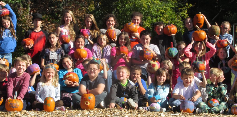 Currier Memorial Students with harvested -- and decorated -- pumpkins.