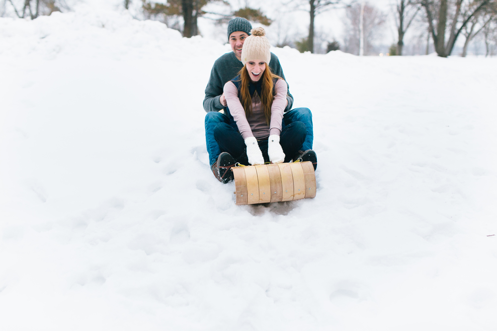 Allison Hopperstad Photography, Engagement Session, Lifestyle Engagement Session, Minnesota Engagement Session, Minnesota Engagement, Minnesota Wedding Photographer, Wedding Photographer, Minnesota Engagement Photographer, Engagement Photographer, Engagement Ring, Woods Engagement, Engagement Session in the Woods, Winter Engagement Session, Sledding Engagement Session, Toboggan Engagement Session, Snowing Engagement Session
