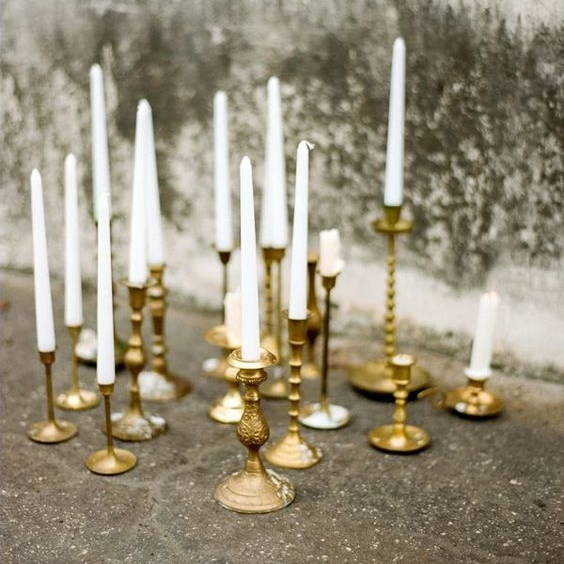 "Brass Taper Candlesticks   Size: Ranges 3"" - 12"" tall Quantity: 230 Rental: $1 each"