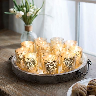 "Gold   Mercury Votives  Size: 2.5"" tall Quantity: 200 Rental: $.75 each"