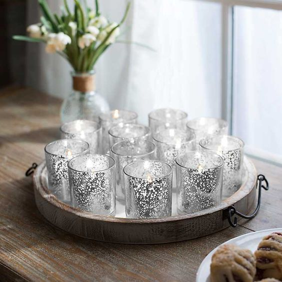 "Silver Mercury Votives  Size: 2.5"" tall Quantity: 50 Rental: $.75 each"