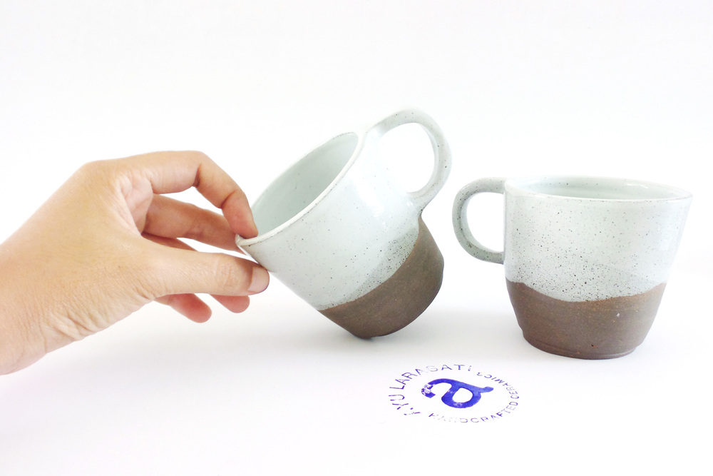 My recent cups made with Sukabumi Clay and 10% Zirconium Glaze to create the white and fired using reduction gas kiln.