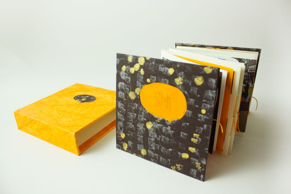 The paper color used were opposites. Black on yellow for the case, and yellow on black for the book cover with title.