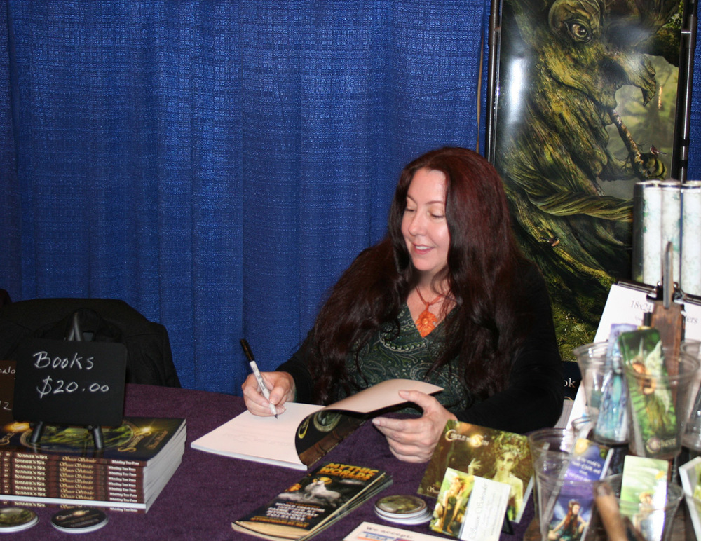 Me at the booth signing books