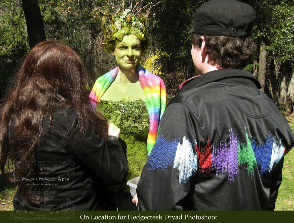 We drove up to the location site and continued the process of makeup, hair and costuming. The headdress and costume were hand made with all that moss sewn on piece by piece to the crown and bodice. It was chilly that day so we were sure to wrap our model in a rainbow blanket!                              That's me on the left and my videographer on the right. On a shoot like this I needthe help of a big creative team to keep everything running smoothly as I work on finishing all the details on the model.  -