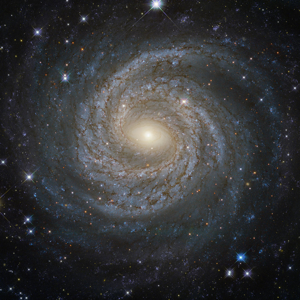 Spiral Galaxy NGC 6814 taken from NASA website's summary of Hubble images