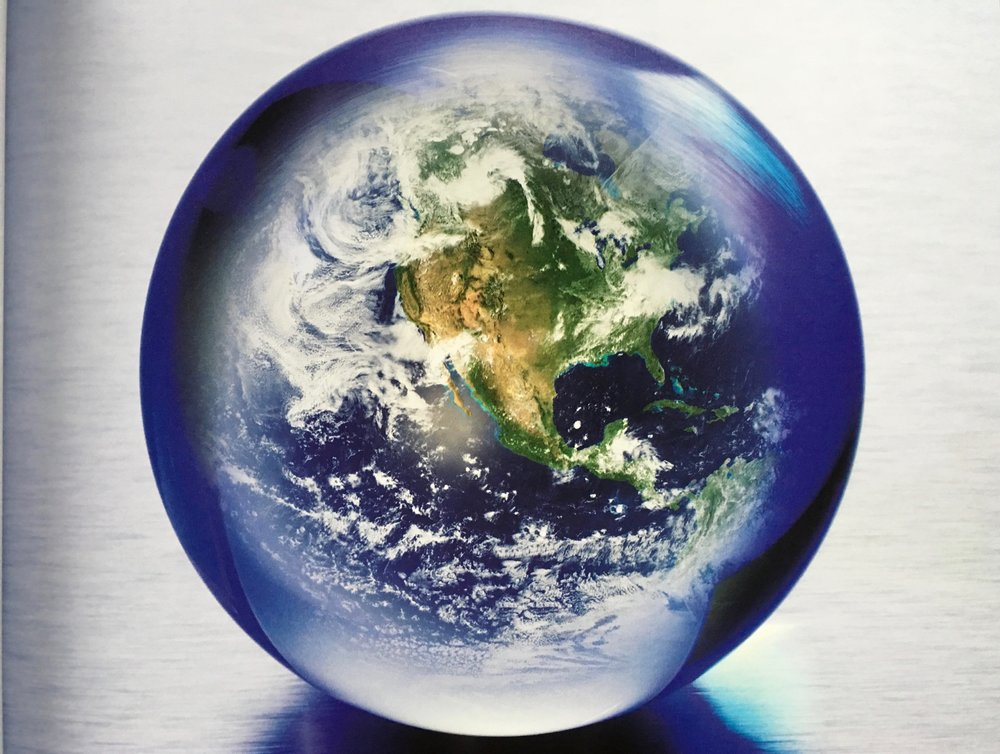 Image of Earth set inside a marble, taken from  Star Talk with Neil deGrasse Tyson