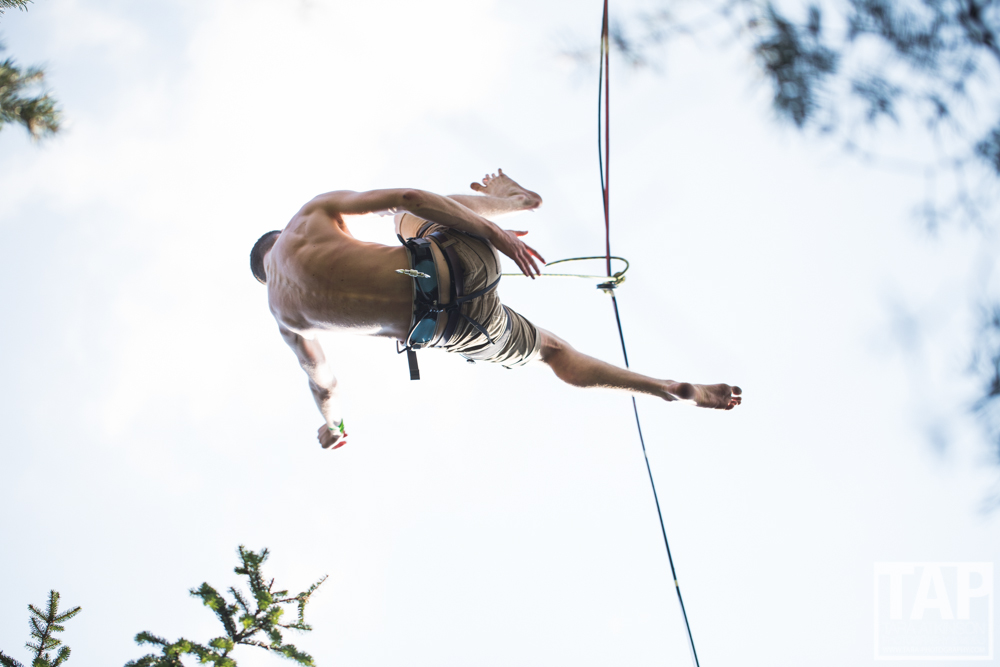 Luke Mckenna falling of a 17m long highline around 30m above the ground on  Adršpach-Teplice Rocks . Luke like many others will follow the highlining festivals across Europe each summer.