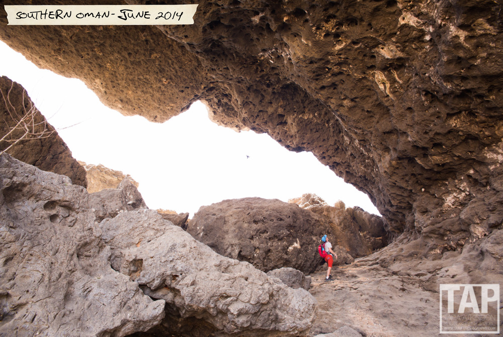 Wadi Darbat, Southern Oman. Pictured is my partner Read exploring the climbing potential in Dhofar in June. The landscape changes dramatically in the monsoon between July- September; with nutrients from the Salalah Khareef it turns lush and green.
