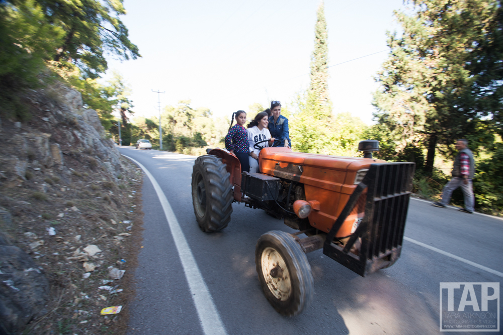 While the women are busy making Gozleme, and the Men drinking coffee and playing board games the children are out driving tractors.