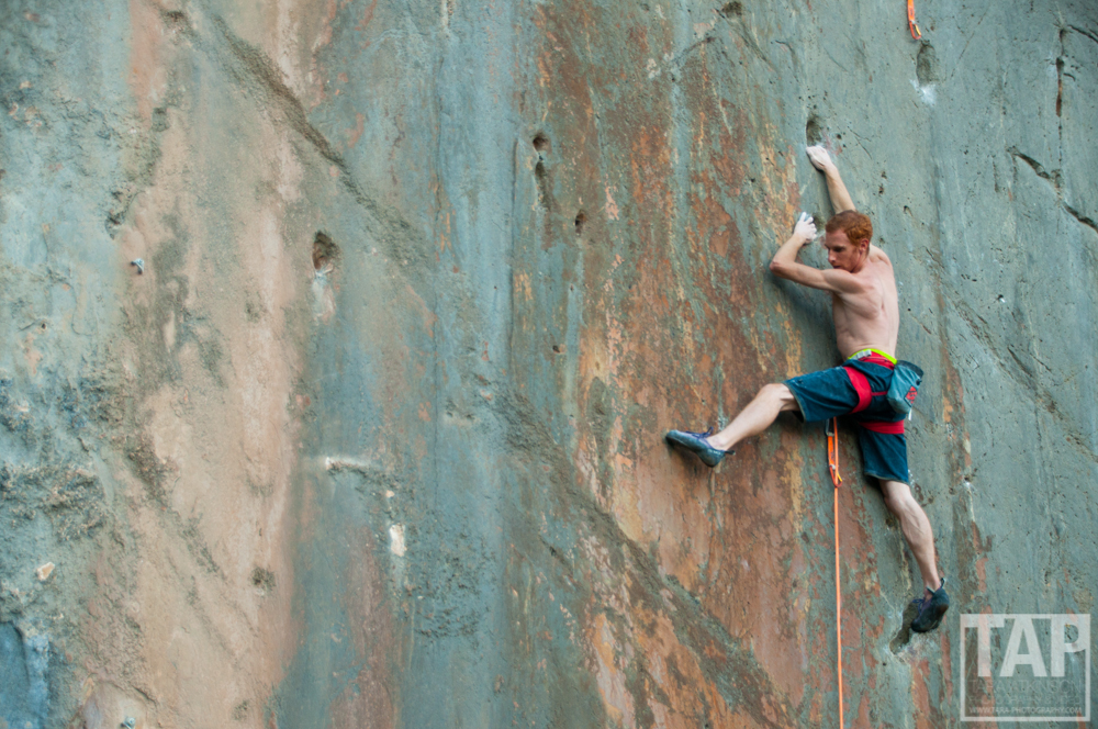 Gabirel Maroney working on an 8b+ on the most beautiful fire red and grey wall I've every seen. Its great to watch such talented climbers and be in the right place at the right time to take the picture.