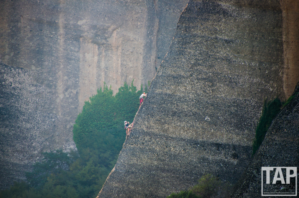 Three climbers taking on an epic multipitch route on a 200m+ tower in Meteora.