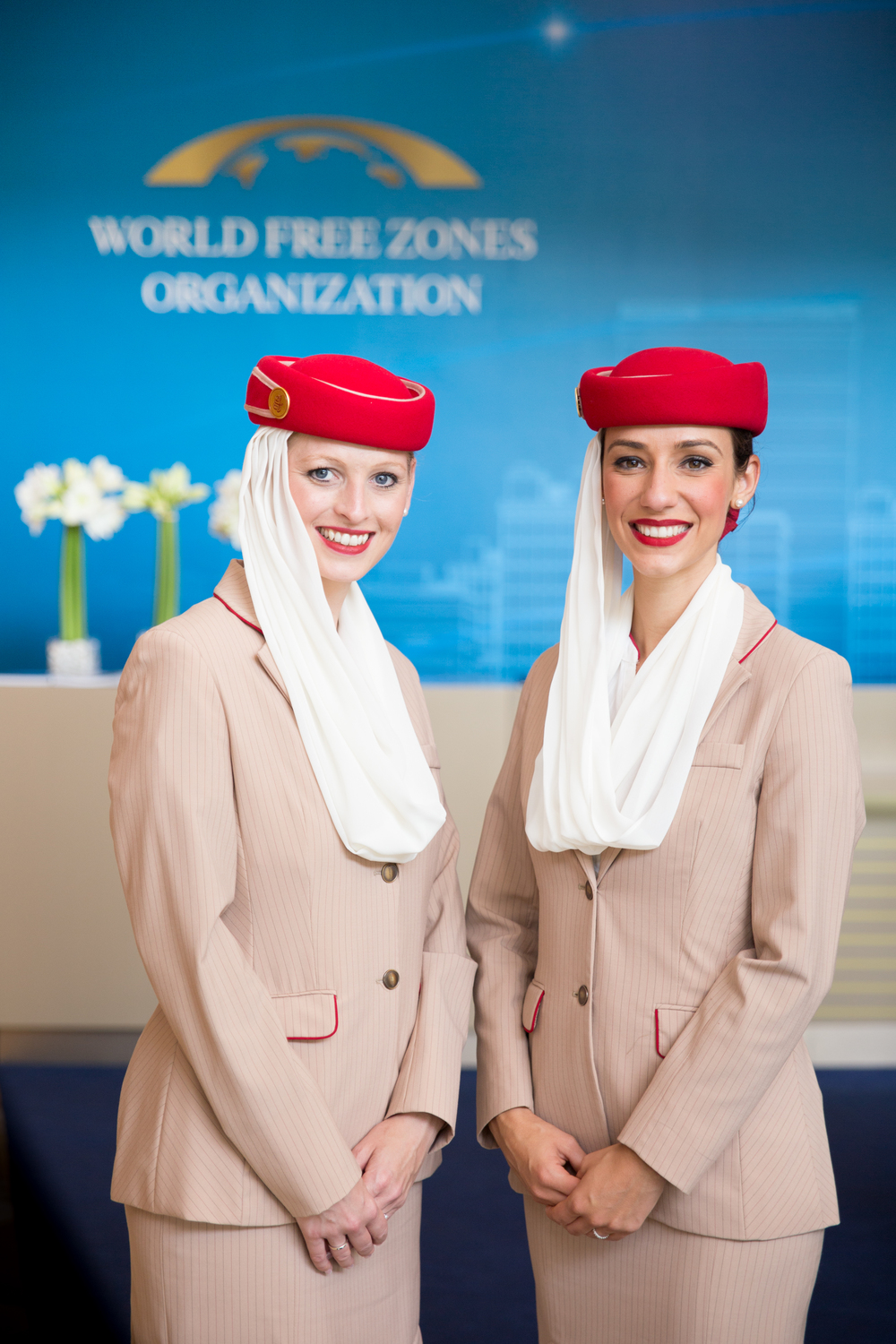 Coverage for World Free Zones organisation conference in Dubai. Two lovely Emirates Air hostesses pose for a photo.