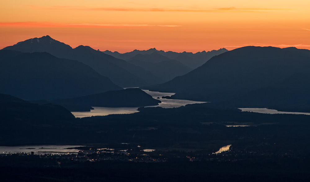 A view of a summer sunset over Port Alberni, the Alberni Valley, and Sproat Lake