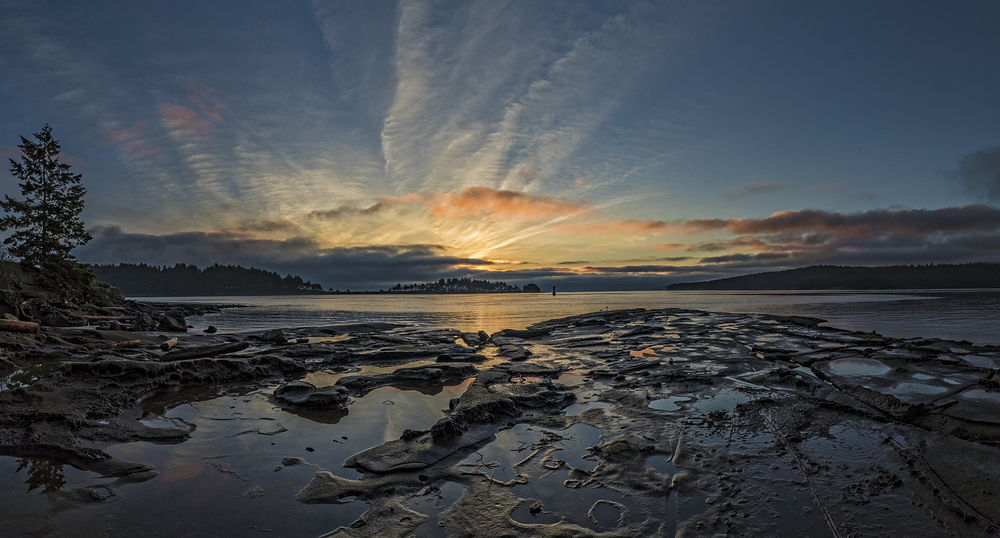 An 8 shot panorama of Drumbeg Bay Park at sunrise. Shot handheld.