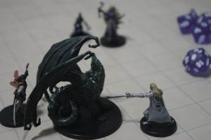 D&D miniatures and dice. Photo by flickr user fireflythegreat.