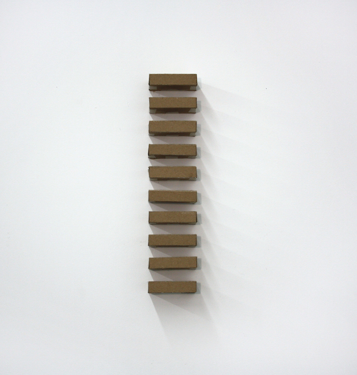 "Untitled (Judd Stack) , 2014, cardboard, masking tape, 16"" x  3.5"""