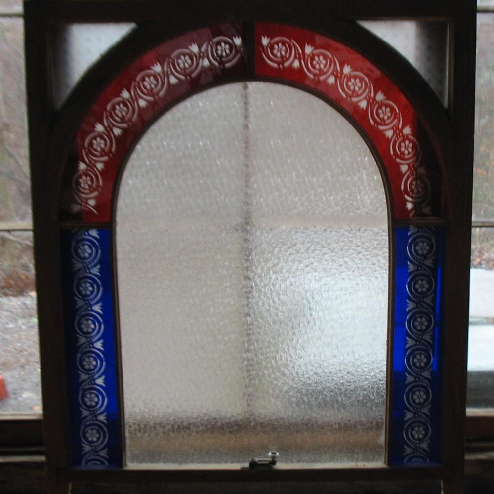 Magnificent Piece of Ruby Red and Cobalt Blue stained glass with floral etchings in each colored piece with Italian Crinkle Glass in center. Has original hardware at bottom of glass. Price: $675