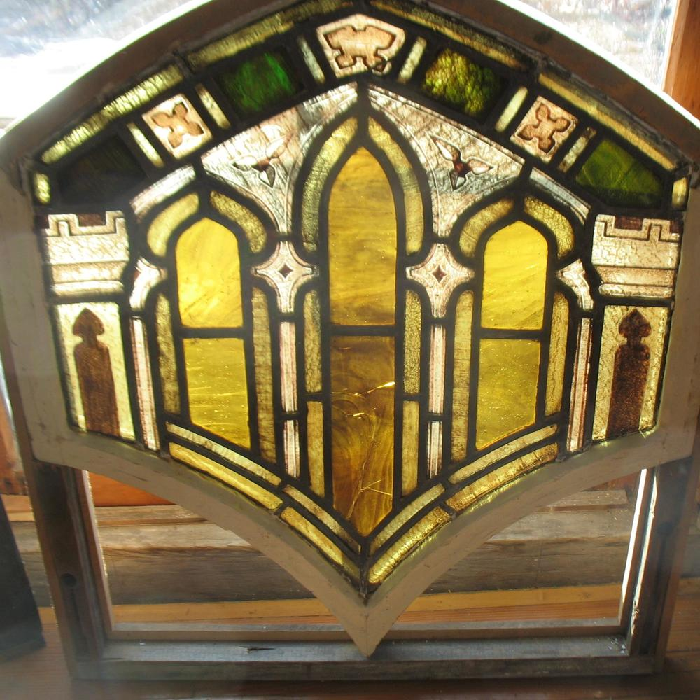 Stained Glass in unusual colors of Gold and Brown and is concave at top of window which again is very unusual Price: $550