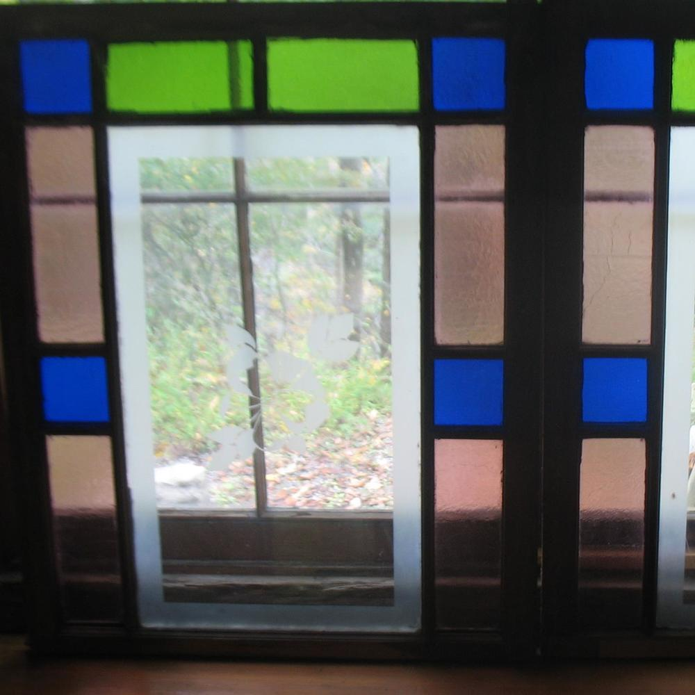 Pair Stained Glass Windows with Butterfly etchings in blues, pinks and greens Price: $650