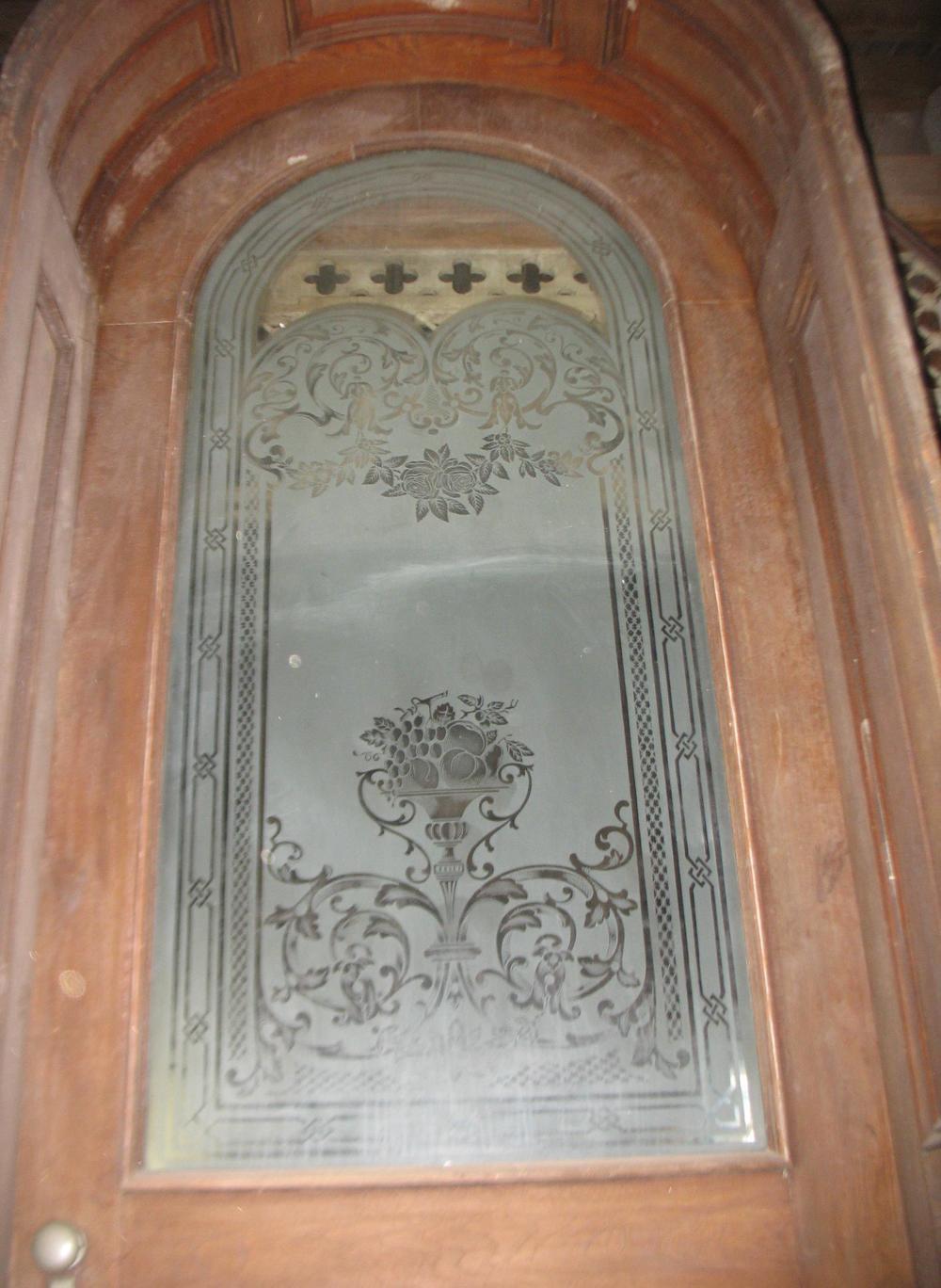 Detail of deep etching in center glass of door