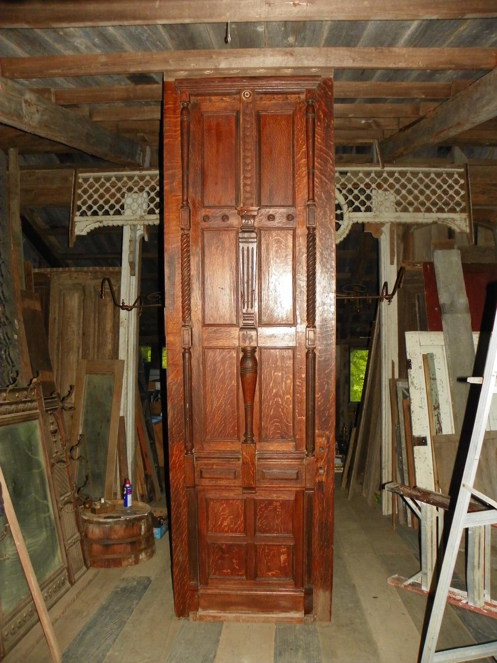 Magnificent Quarter Sawn Oak door with all brass original hardware. 10 feet tall and 4 feet wide. What an Entrance Door!!!