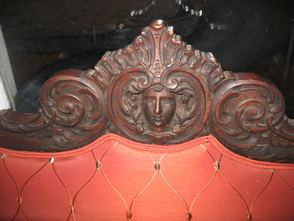 Showing beautiful detail of wood carving of ladies face