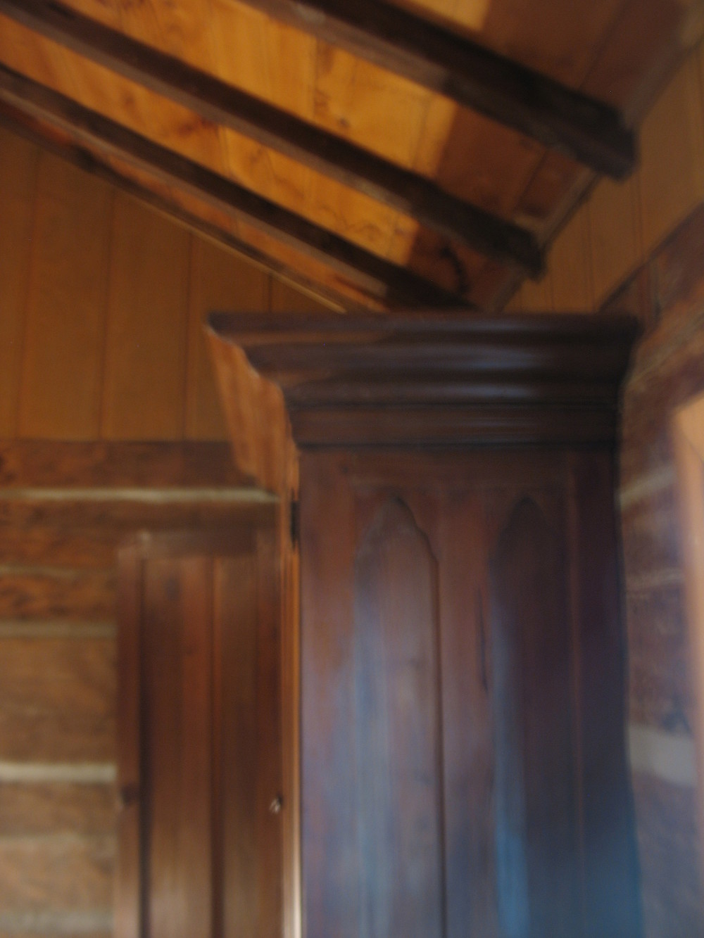 This is a side view of the wardrobe and shows the beauty and the depth of the crown molding
