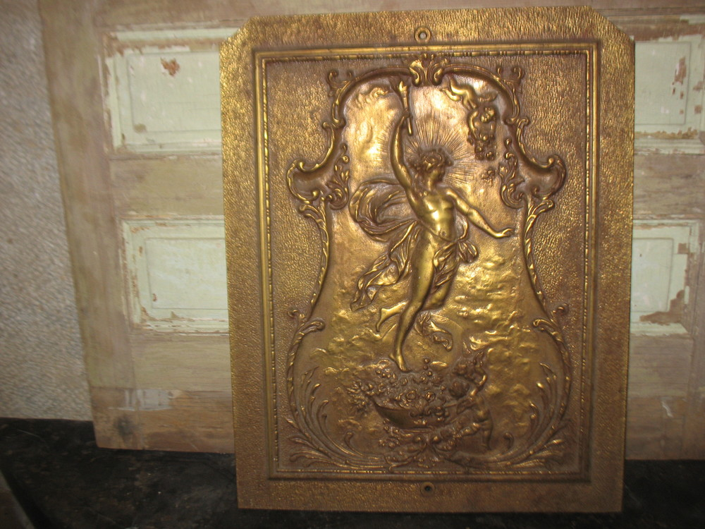 Fabulous heavy Brass piece from a stone column at the entrance to a mansion in Newport,Rhode Island.  It would make a fantastic wall hanging or a fireplace cover in the summertime. It belongs in a special place in a special home.  It measures 25 inches tall X 20 inches wide. Price on request