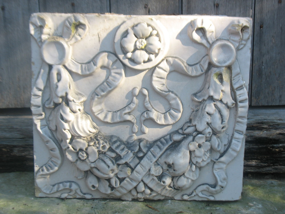 Wonderful molded frieze with decorative rose on top of wreath.  Very heavy and solid.  14 inches tall X 16 inches wide. Great garden piece or on a shelf in a special place.