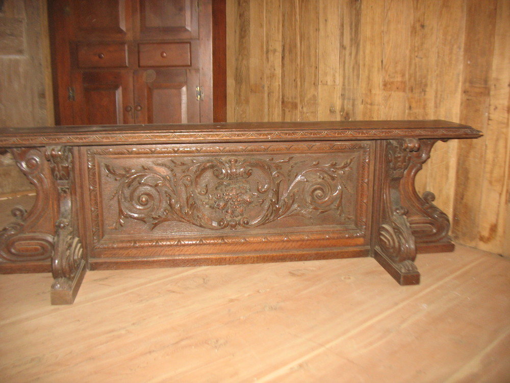 If you want an unusual piece this fills the order.  Beautifully carved Victorian piece which measures 69 inches long X 16 inches wide from front to back and 22 inches tall. The shelf on top is18 inches wide.  I used it at the end of my bed with pillows, but it can be hung as a shelf or as a seat with pillows or a cushion. Absolutely beautiful in detail. Price: SOLD