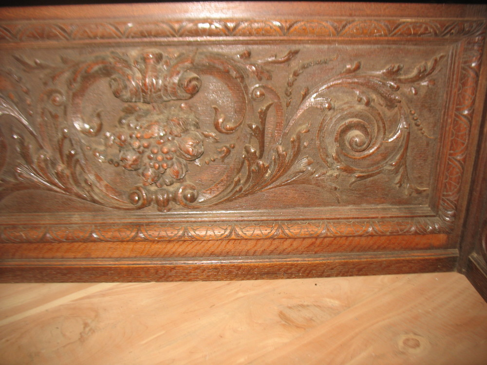 This shows detail of carved design which is in the center of the piece.