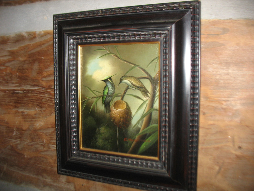 This is an oil painting signed by the artist , R. Heartman in its original Victorian Frame.  It is a lovely scene showing  a pair of hummingbirds tending their nest .Overall measurements including frame are 14 inches wide X 16 inches in height.  ca: 1890