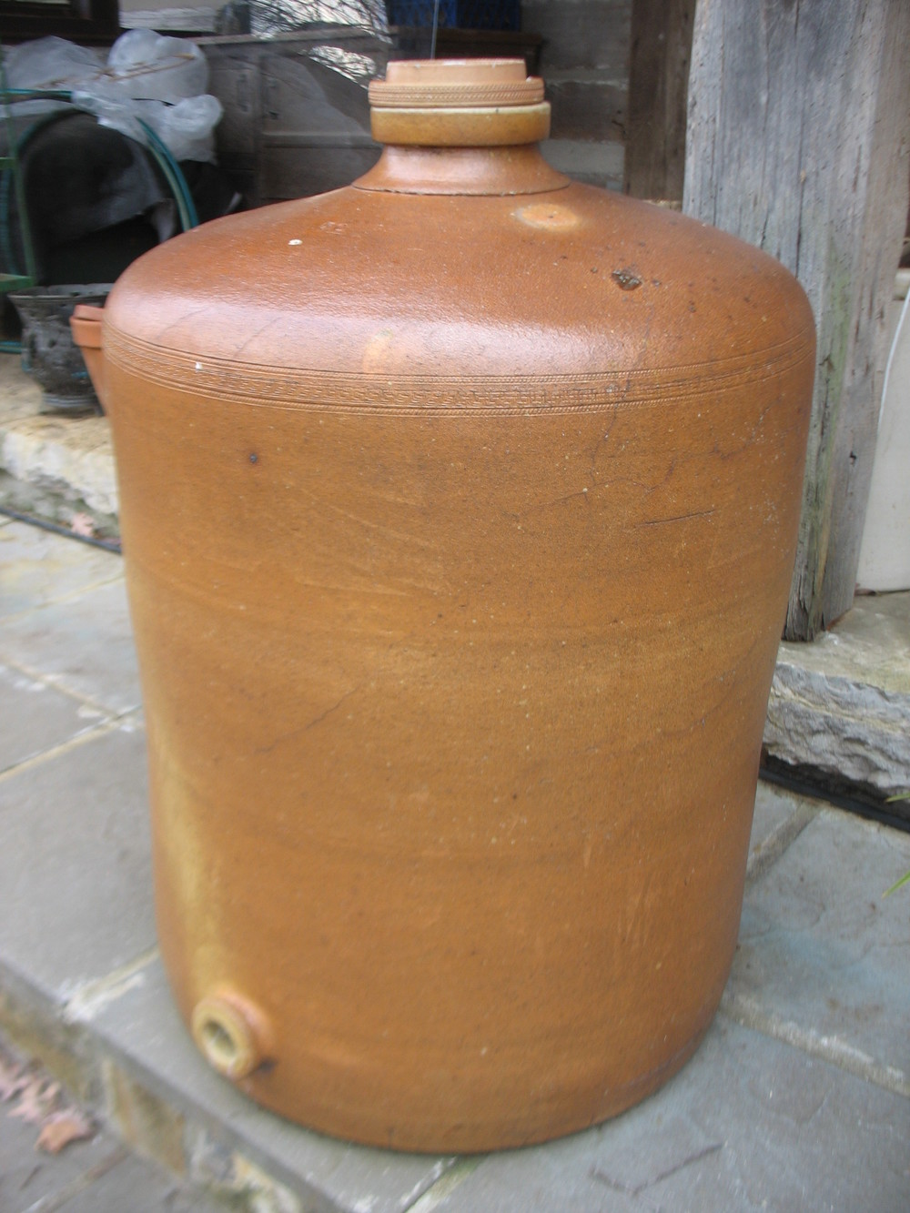 French Wine Crock with decorative design around top of main crock. Has lid with decorative design around edges and remnants of the original stamp are still visible. Measures 80 inches around and is 3 feet 2 inches tall. This is part of Braxton Dixon's unique collection of pieces collected over 70 years. Price upon request