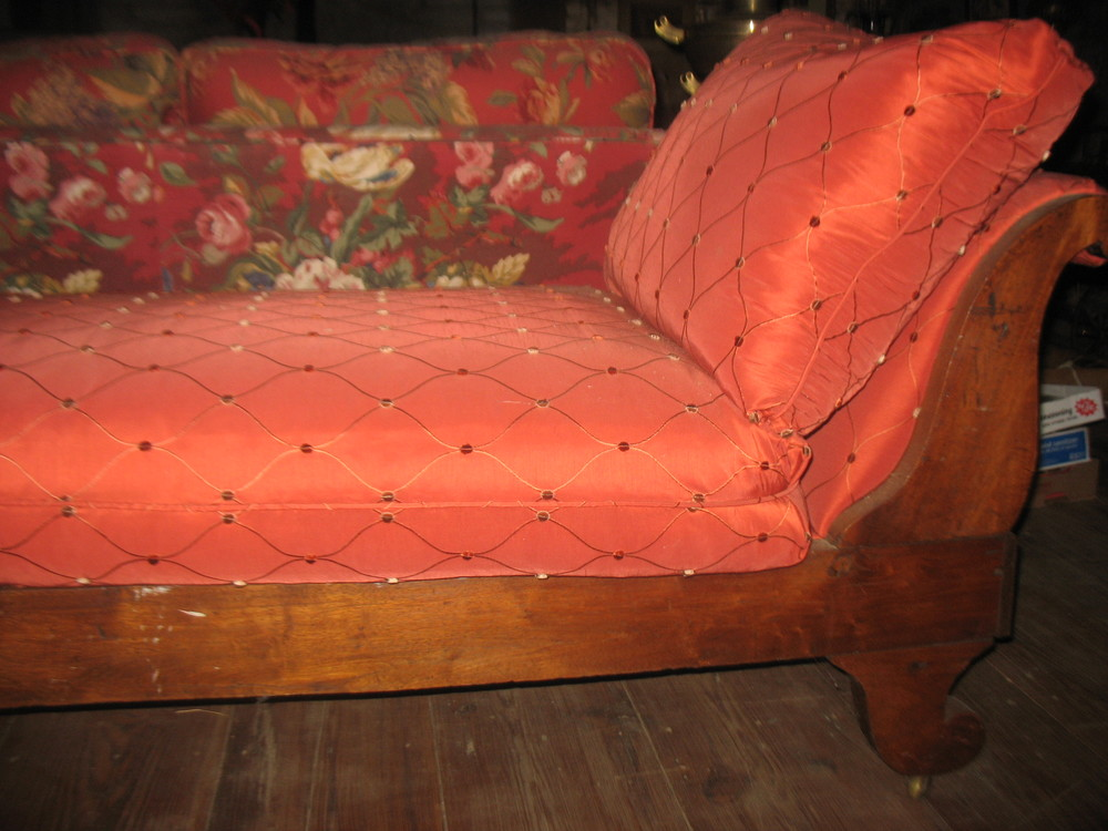 Wonderful 1800's Chaise.  This was the epitome of luxury of that era. It has beautifully shaped back and legs with deep dovetailing at ends.  It's frame is of poplar and is as sturdy today as the day it was made.  It measures 6 feet long, 30 inches tall at the back and 14 inches tall at the foot.  It is 26 inches wide.  There is a down cushion which is66 inches long, 30 inches wide and 10 inches thick. The pillow is 20 inches wide, 25 inches long and 16 inches thick. The fabric is a red nubby silk.