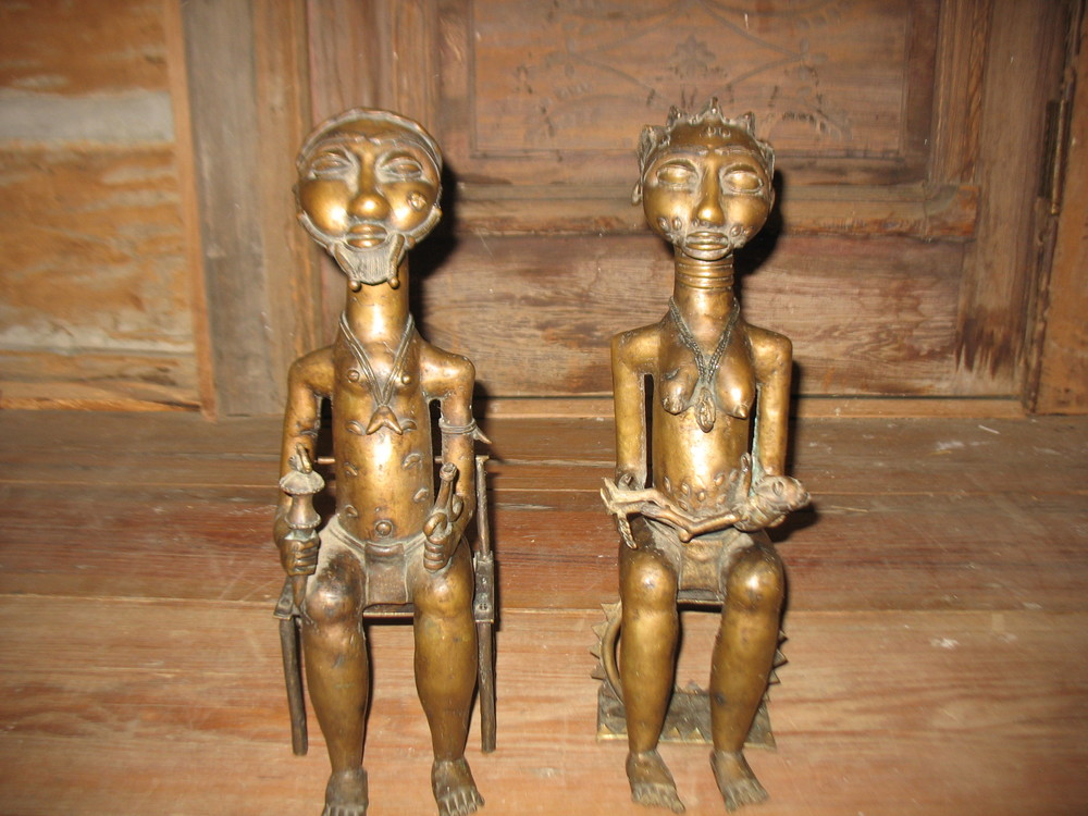 Regal Pair African Bronze Sculptures.  King and Queen with baby in her lap are of the African tribal art and beautifully cast. Each figure sits in his throne chair. The chairs are separate from the bodies.  The detail of the hair styles are indicative of the Ashanti Tribe which was in Ghana. Price on request