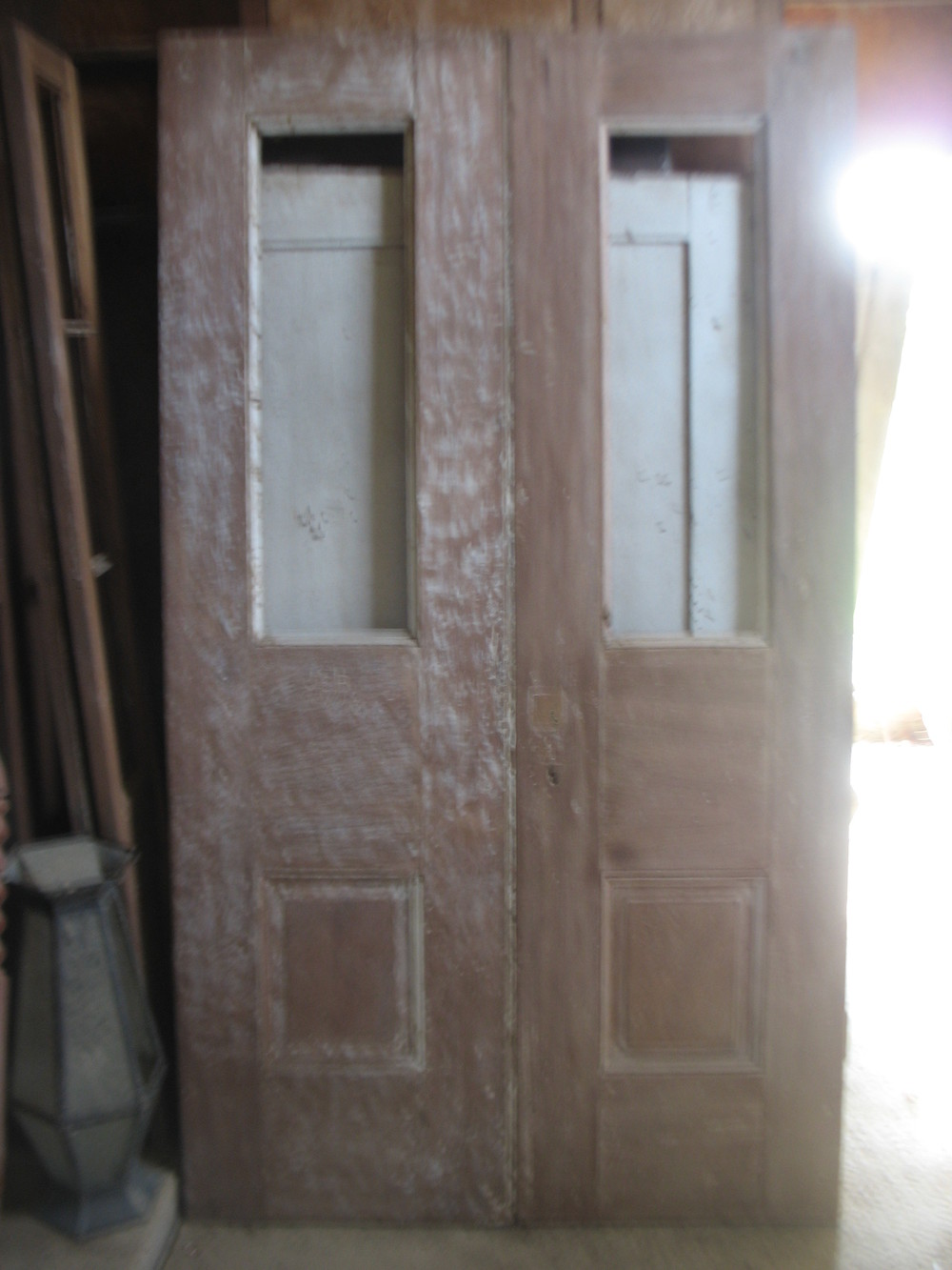 Pair of wonderful 1800's poplar doors with inserts for either beveled glass or stained glass.  Great Entrance Doors or into any special room in your house. They measure 10 feet tall and 6 feet wide.