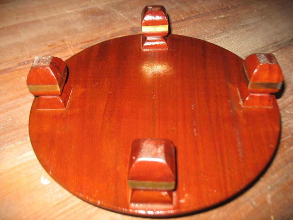This shows the bottom of the foot stool with its 4 little carved feet.