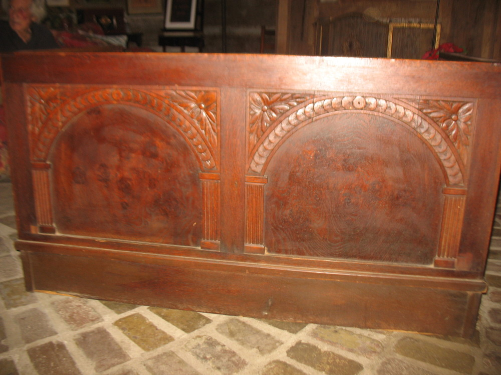 This shows the back and the elaborate oak carving of the settee.