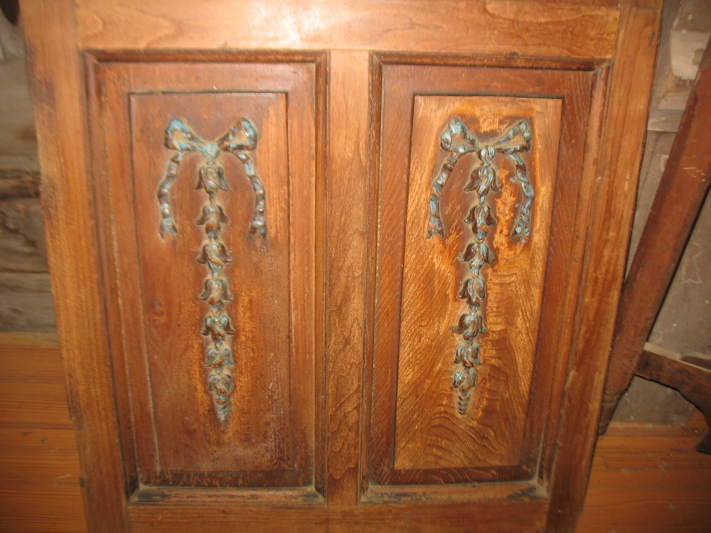 This is a pair of decorative cabinet doors. Beautifully hand carved bows with flowers make these doors so special.  Measurements are 36 inches wide and 42 inches tall. Price: SOLD