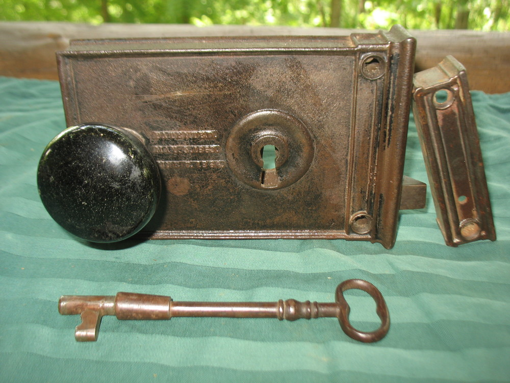 This lock with original black porcelain door knobs, striker, and key was on the door I built on Old Hickory Lake for Johnny Cash.  It is signed and dated: D M and Co., New Haven, Ct.  patented  May 5, 1863 and June 7,1864. This lock was on the door on the lower floor and was used as the entrance door from the carport where he parked his cars. Price upon request