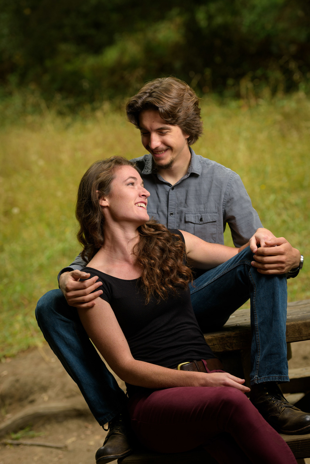Couple sitting on a bench - Engagement Photos in Nisene Marks Forest in Aptos, CA - by Bay Area wedding photographer Chris Schmauch